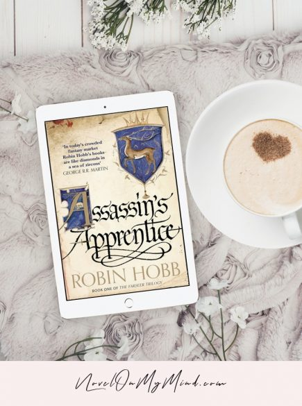A tablet with open cover for the book Assassin's Apprentice by Robin Hobb