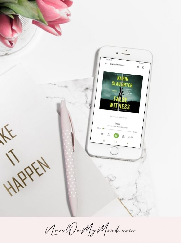 An audiobook cover of False Witness by Karin Slaughter opened on a phone